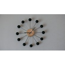 The clock with rays and black balls